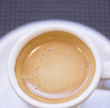 expresso: Expresso coffee cup and saucer on table of Italian restaurant.