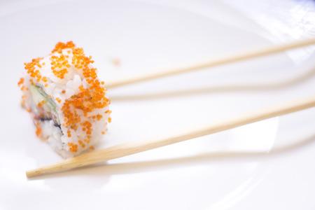 Japanese restaurant sushi oriental raw fish smoked salmon food dish and traditional Asian wooden chopsticks photo. Zdjęcie Seryjne - 53526427
