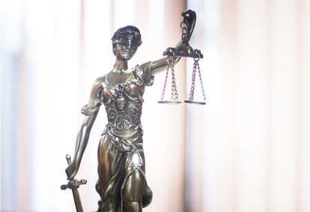 blind justice: Legal blind justice metal statue with scales in chain in law firm offices photo.