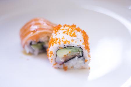Japanese restaurant sushi oriental raw fish smoked salmon food dish and traditional Asian wooden chopsticks photo. Zdjęcie Seryjne - 53527153