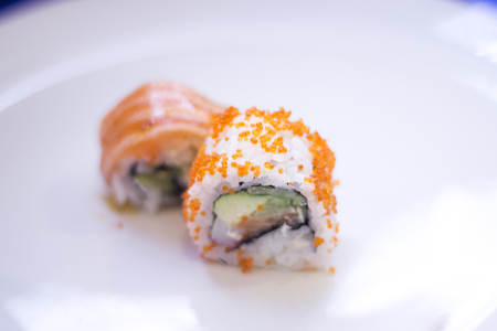 Japanese restaurant sushi oriental raw fish smoked salmon food dish and traditional Asian wooden chopsticks photo. Zdjęcie Seryjne - 53527656