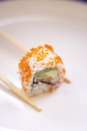 Japanese restaurant sushi oriental raw fish smoked salmon food dish and traditional Asian wooden chopsticks photo. Zdjęcie Seryjne - 53709320
