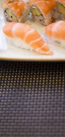 Japanese restaurant sushi oriental raw fish smoked salmon food dish and traditional Asian wooden chopsticks photo. Zdjęcie Seryjne - 53972821