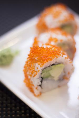 Japanese restaurant sushi oriental raw fish smoked salmon food dish and traditional Asian wooden chopsticks photo. Zdjęcie Seryjne - 53529227