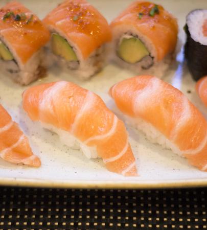 Japanese restaurant sushi oriental raw fish smoked salmon food dish and traditional Asian wooden chopsticks photo. Zdjęcie Seryjne - 53529539