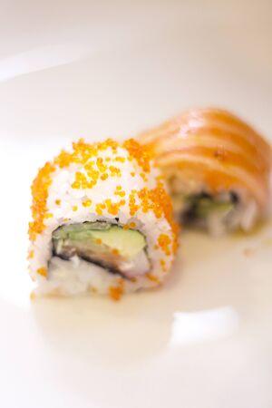 Japanese restaurant sushi oriental raw fish smoked salmon food dish and traditional Asian wooden chopsticks photo. Zdjęcie Seryjne - 53654863