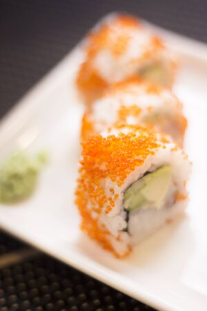 Japanese restaurant sushi oriental raw fish smoked salmon food dish and traditional Asian wooden chopsticks photo. Zdjęcie Seryjne - 54190695