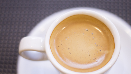 Expresso coffee cup and saucer on table of Italian restaurant.