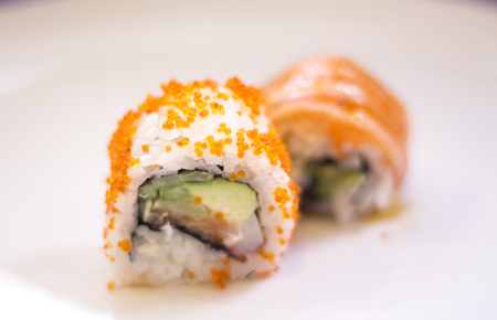 Japanese restaurant sushi oriental raw fish smoked salmon food dish and traditional Asian wooden chopsticks photo. Zdjęcie Seryjne - 53531779