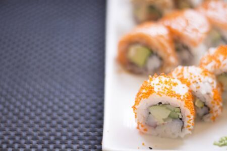 Japanese restaurant sushi oriental raw fish smoked salmon food dish and traditional Asian wooden chopsticks photo. Zdjęcie Seryjne - 53531783