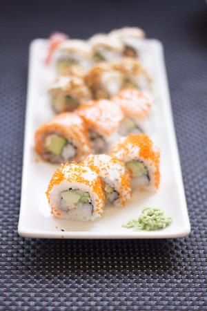Japanese restaurant sushi oriental raw fish smoked salmon food dish and traditional Asian wooden chopsticks photo. Zdjęcie Seryjne - 53532142