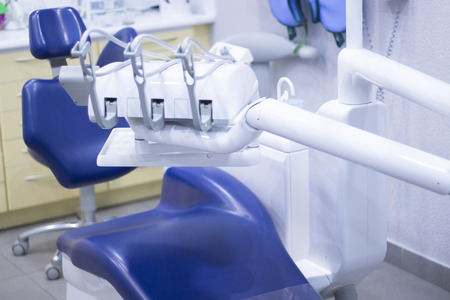 operating hygiene: Dentists chair and dental drill in hospital clinic.