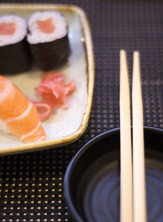 Japanese restaurant sushi oriental raw fish smoked salmon food dish and traditional Asian wooden chopsticks photo. Zdjęcie Seryjne