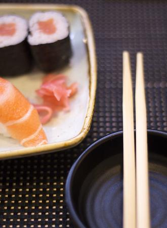 Japanese restaurant sushi oriental raw fish smoked salmon food dish and traditional Asian wooden chopsticks photo. Zdjęcie Seryjne - 53709330