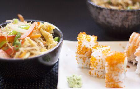 Japanese restaurant sushi oriental raw fish smoked salmon food dish and traditional Asian wooden chopsticks photo. Zdjęcie Seryjne