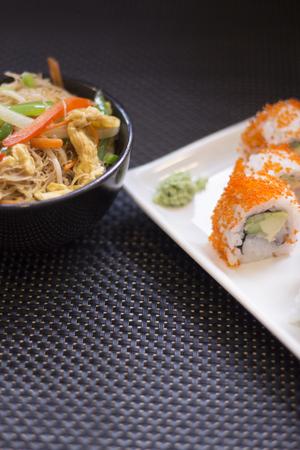 Japanese restaurant sushi oriental raw fish smoked salmon food dish and traditional Asian wooden chopsticks photo. Zdjęcie Seryjne - 53709341