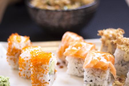 Japanese restaurant sushi oriental raw fish smoked salmon food dish and traditional Asian wooden chopsticks photo. Zdjęcie Seryjne - 53655111