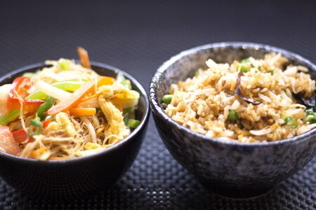 chinese meal: Japanese restaurant egg fried rice vegetables food dish photo. Stock Photo