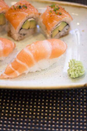 Japanese restaurant sushi oriental raw fish smoked salmon food dish and traditional Asian wooden chopsticks photo. Zdjęcie Seryjne - 53654969