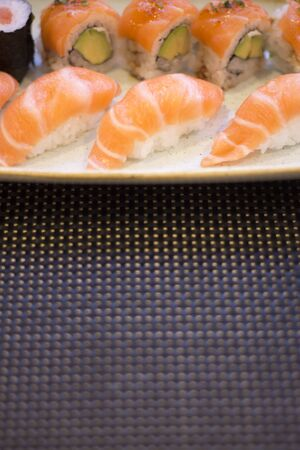 Japanese restaurant sushi oriental raw fish smoked salmon food dish and traditional Asian wooden chopsticks photo. Zdjęcie Seryjne - 54056375