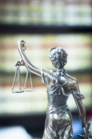 judicature: Legal blind justice metal statue with scales in chain in law firm offices photo.