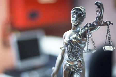 Legal blind justice metal statue with scales in chain in law firm offices photo. Banco de Imagens - 53590146