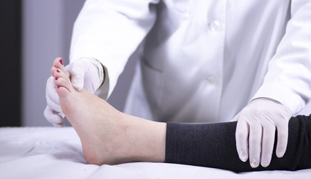 Traumatology and orthopedics surgeon in doctor and patient orthopedic medical examination consultation of foot, ankle and toes in hospital clinic.