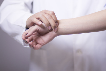 Traumatology and orthopedics surgeon in doctor and patient orthopedic medical examination consultation for hand, fingers, arm and wrist in hospital clinic.
