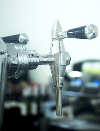 draught: Draught beer pump tap in pub bar photo.