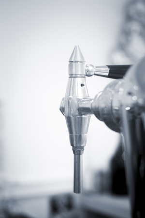 beer pump: Draught beer pump tap in pub bar photo.