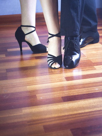 salsa dancer: Male and female ballroom, standard, sport dance, latin and salsa couple dancers feet and shoes in dance academy school rehearsal room dancing modern contemporary style.