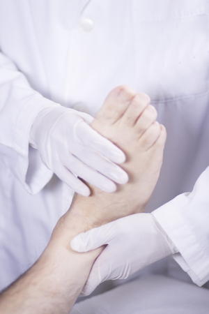 traumatology: Traumatology and orthopedics surgeon in doctor and patient orthopedic medical examination consultation of foot, ankle and toes in hospital clinic.