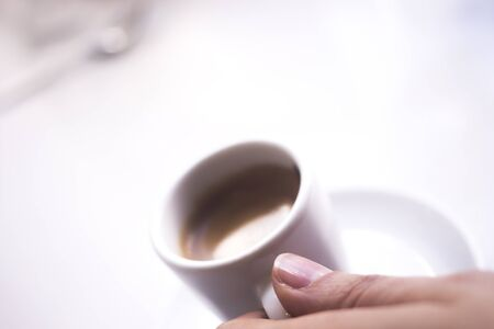 expresso: Expresso coffee cup and saucer in Italian restaurant cafe. Stock Photo