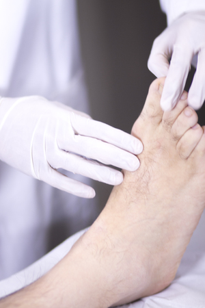 foot doctor: Traumatology and orthopedics surgeon in doctor and patient orthopedic medical examination consultation of foot, ankle and toes in hospital clinic.