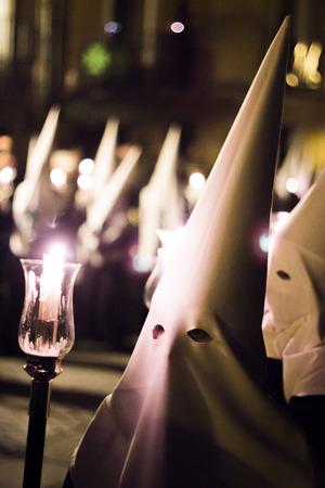 semana: Easter catholic Spanish procession Semana Santa. Catholics wear pointed hoods like KLu Klux Klan.