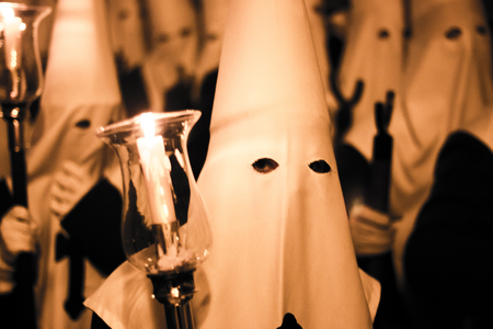 the believer: Easter catholic Spanish procession Semana Santa. Catholics wear pointed hoods in Andalusian culture. Stock Photo