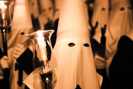 semana: Easter catholic Spanish procession Semana Santa. Catholics wear pointed hoods in Andalusian culture. Stock Photo