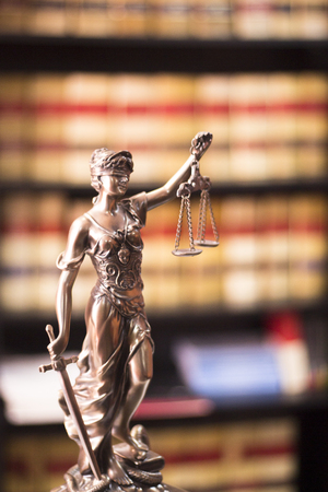 judicature: Legal blind justice Themis metal statue with scales in chain in law firm offices photo.