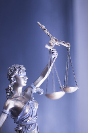 themis: Legal blind justice Themis metal statue with scales in chain in law firm offices photo.