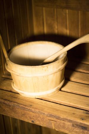 finland sauna: Wood sauna bucket and ladle spoon photo. Stock Photo