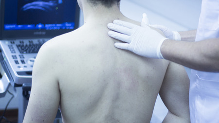 Ultrasound assisted ecography intratissue percutaneous electrolysis shoulder diagnosis in physical therapy physiotherapist treatment in medical center IPE physiotherapy clinic.
