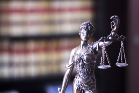 Legal blind justice Themis metal statue with scales in chain in law firm offices photo. Banco de Imagens - 59270599