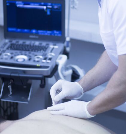 assisted: Ultrasound assisted ecography intratissue percutaneous electrolysis dry needling shoulder and back physiotherapist treatment in hospital medical center IPE physiotherapy clinic.
