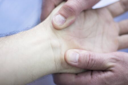 myofascial: Myofascial osteopathy physiotherapy treatment by physiotherapist and osteopath in physical therapy rehabilitation treatment on patient on hand and wrist. Stock Photo