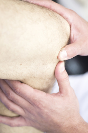 osteopath: Myofascial osteopathy physiotherapy treatment by physiotherapist and osteopath in physical therapy rehabilitation treatment on patient on leg and knee joint. Stock Photo