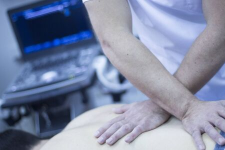 myofascial: Myofascial osteopathy physiotherapy treatment by physiotherapist and osteopath in physical therapy rehabilitation treatment on patient on back.