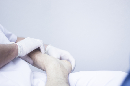 myofascial: Myofascial osteopathy physiotherapy treatment by physiotherapist and osteopath in physical therapy rehabilitation treatment on patient on leg, ankle and foot. Stock Photo