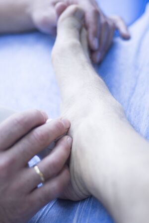 sonography: EPI percutaneous intratissue electrolysis scan to aid dry needling acupunture physiotherapy physical therapy treatment of patient in clinic. Stock Photo
