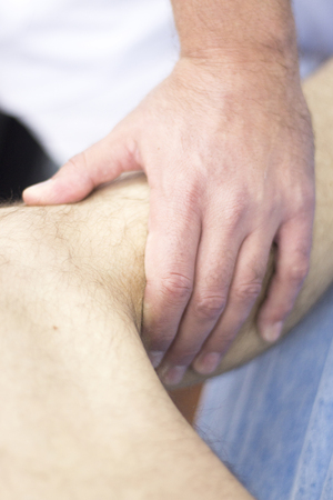 myofascial: Myofascial osteopathy physiotherapy treatment by physiotherapist and osteopath in physical therapy rehabilitation treatment on patient on leg and knee joint. Stock Photo