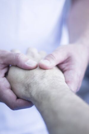 osteopath: Myofascial osteopathy physiotherapy treatment by physiotherapist and osteopath in physical therapy rehabilitation treatment on patient on hand and wrist. Stock Photo